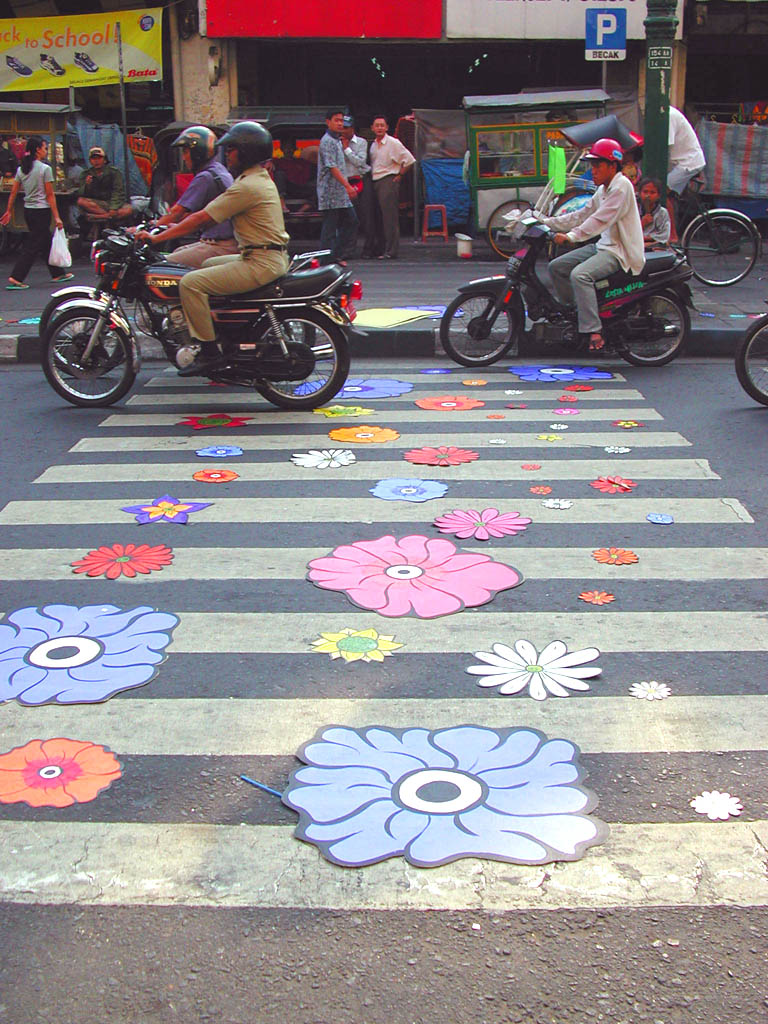 Motorcycles driving over flowers.jpg