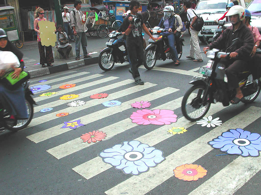 Motorcycles driving over flowers 2.jpg
