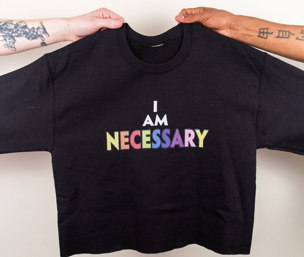 The Unisex 90's crop - Swag it up a bit, with this hand cropped version of the I am necessary black crew neck
