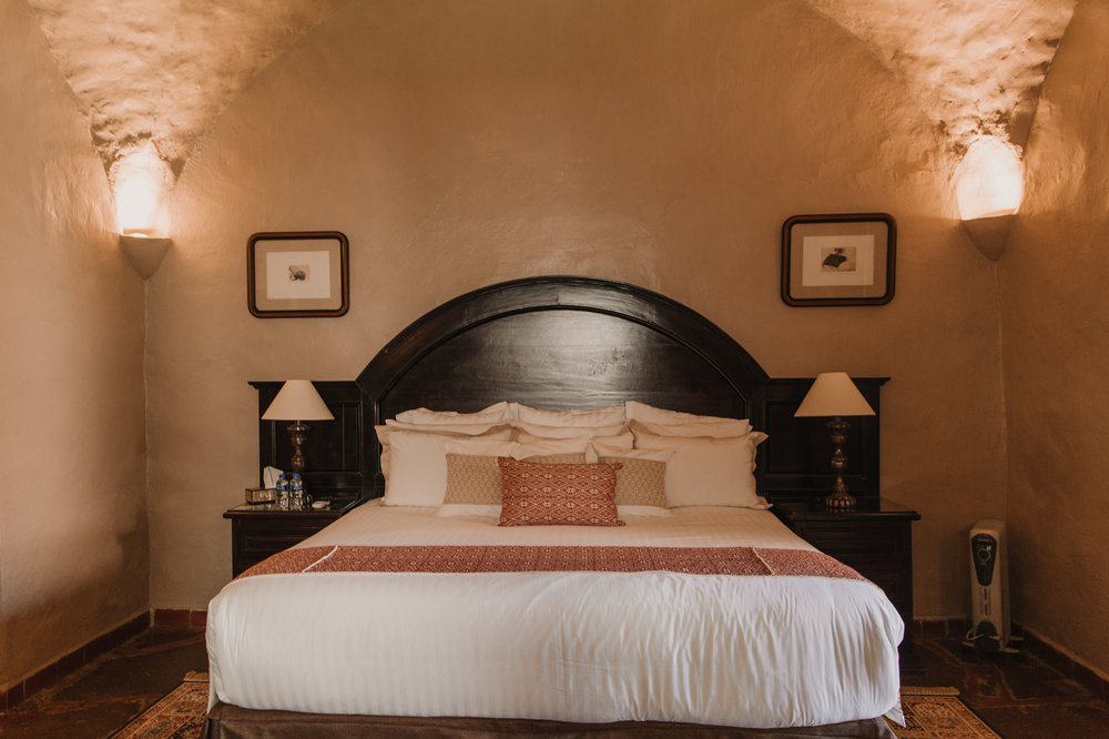 Superior Suite - Una espaciosa habitación con una acogedora y tradicional sala de estar.