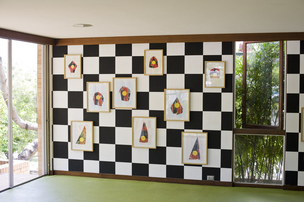 Protest Sail Collages as installed at David Pestorius Projects, Brisbane. Checkerboard wall painting by Heimo Zobernig