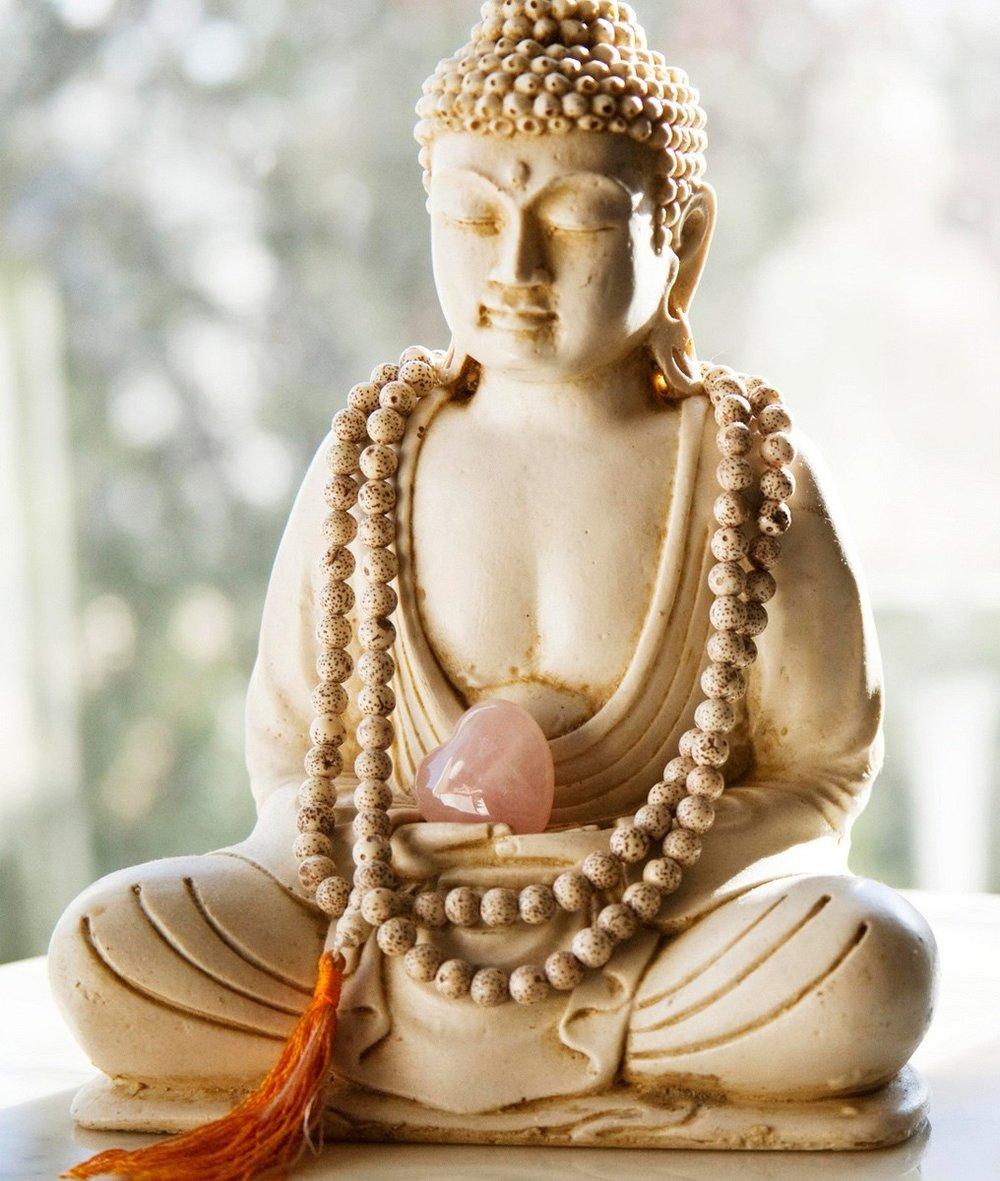 6980816-buddha-statue-stone-heart.jpg