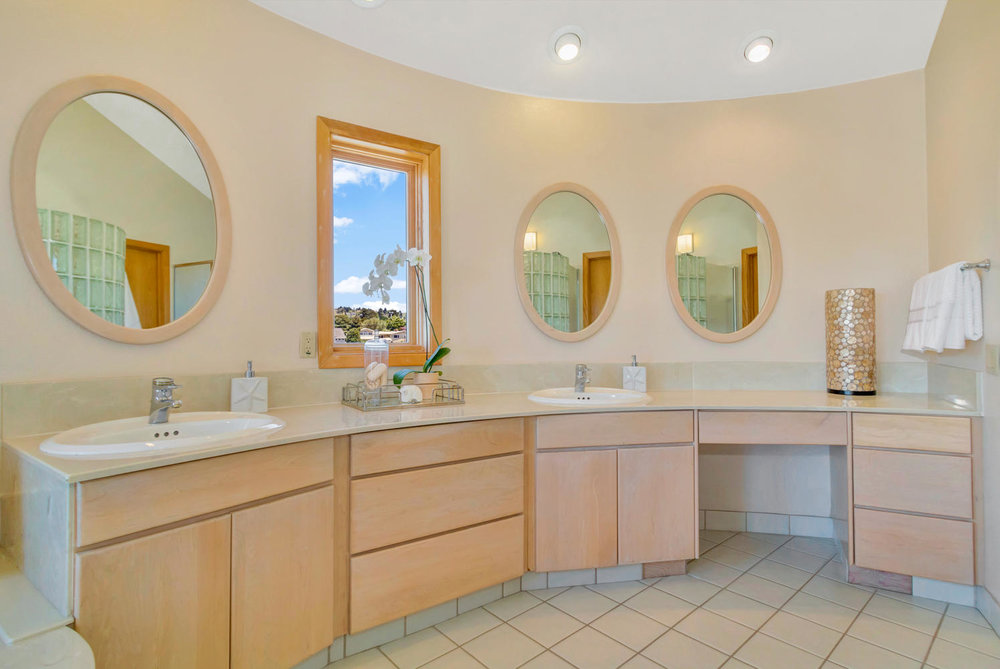 Johns Place Master Bath Coutner Day.jpg
