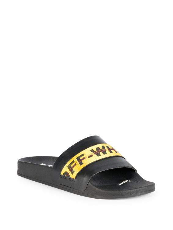 Easy slides with utilitarian logo tape detail  Polyurethane and polyester upper  Open toe  Molded polyurethane footbed  Imported