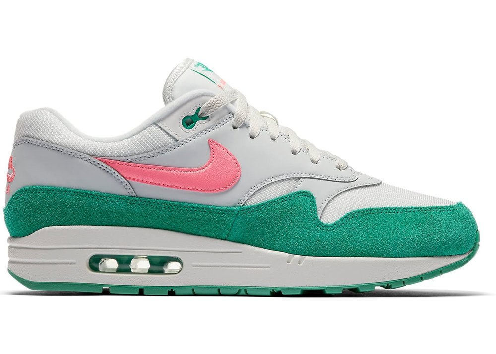 The Nike Air Max 1 Men's Shoe updates the legendary design with new colors and materials while maintaining the same lightweight cushioning of the original.  Shown: Summit White/Kinetic Green/Pure Platinum/Sunset Pulse  Style: AH8145-106