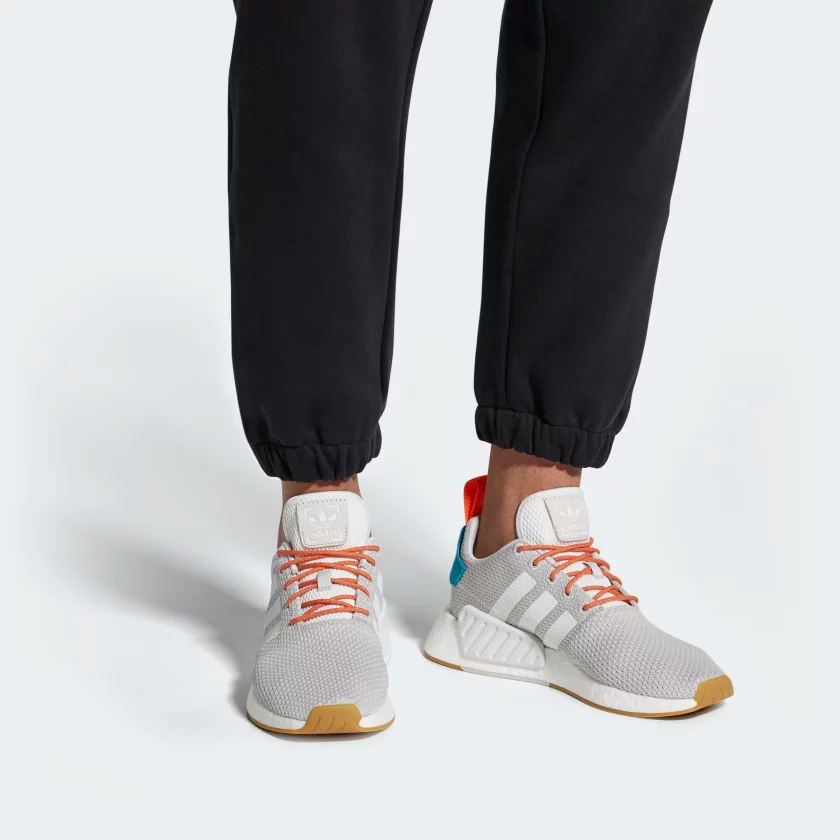WARM-WEATHER SHOES THAT BLEND ADIDAS HERITAGE WITH MODERN COMFORT.  The NMD_R2 mixes modern engineering with a vintage soul. These shoes have a knit upper that's built to flex and breathe, plus the responsive comfort of Boost. Outfitted for hot days Mesh lining features cool-touch yarn Sockliner with Outlast® technology helps regulate foot temperature Distinctive Boost midsole Boost is our most responsive cushioning ever Signature NMD details A signature heel pull plus EVA midsole plug