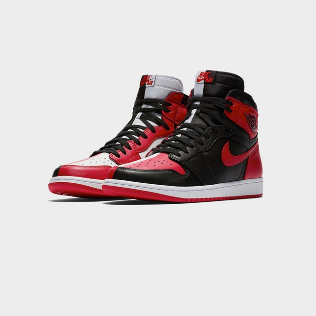 "Jordan Brand loves to give their iconic colorways a special treatment and next in line is a banger, two iconic colorways in one shoe. The Air Jordan 1 High OG ""Homage To Home"" combines the classic colorways of the Chicago and Banned/ Bred Jordan 1s. The design splits both color schemes right down the middle, the Chicago colorway on the medial side, while the Banned theme takes on the lateral side. The Nike Air tongue-tag is also split in half just to be finished off by a white midsole and red outsole."