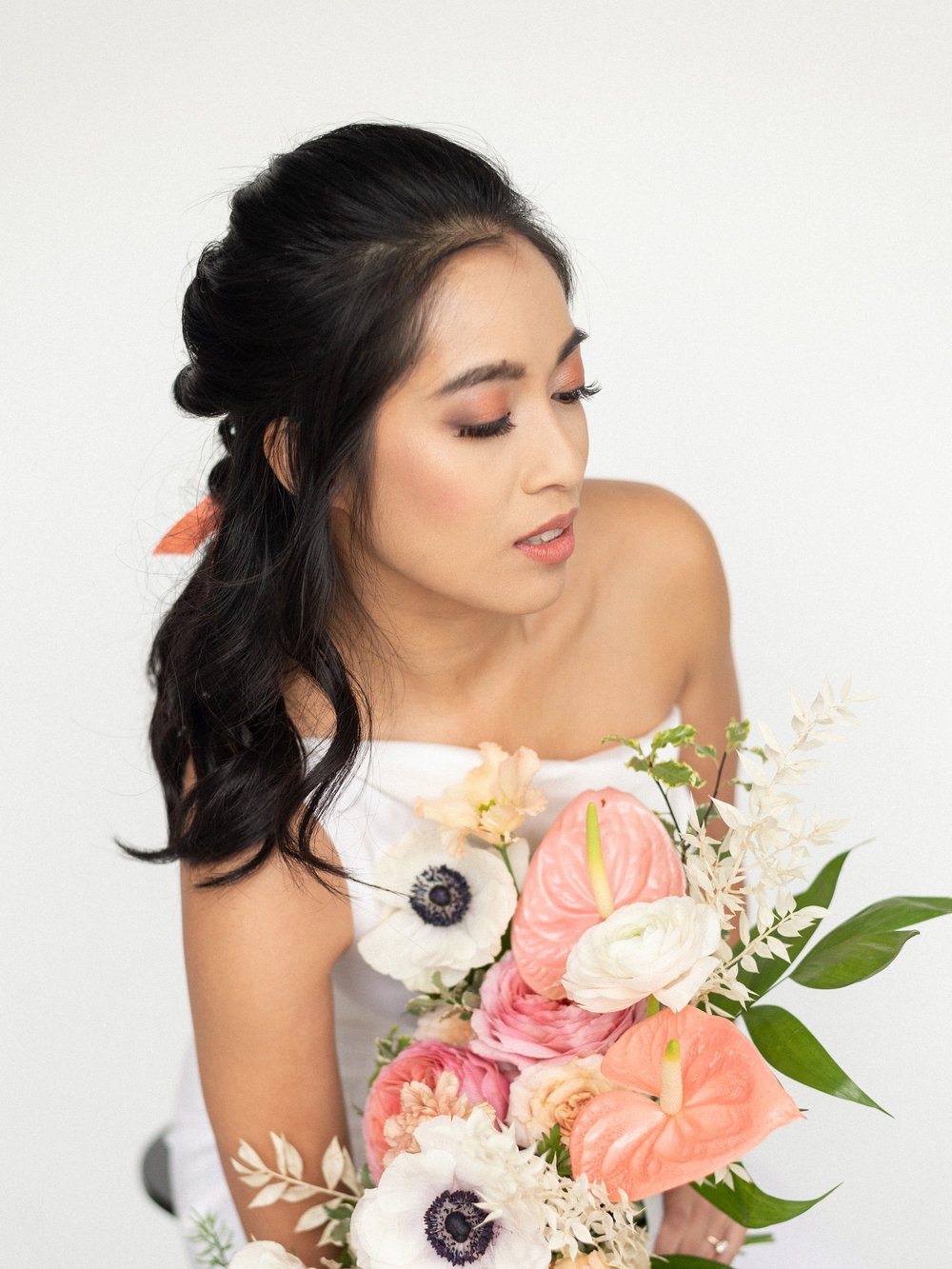 Coordinated by  Lyons Events.  Photo by  BeatBox Portrait,  Flowers  Katie Bug Florals,  Jumpsuit by  Elizabeth Lee Bridal