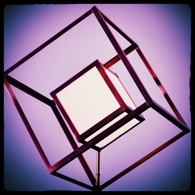 Model of the the tesseract/hypercube/power cube. This incredible rotation centerpiece to our art installation stands 3 times human height.