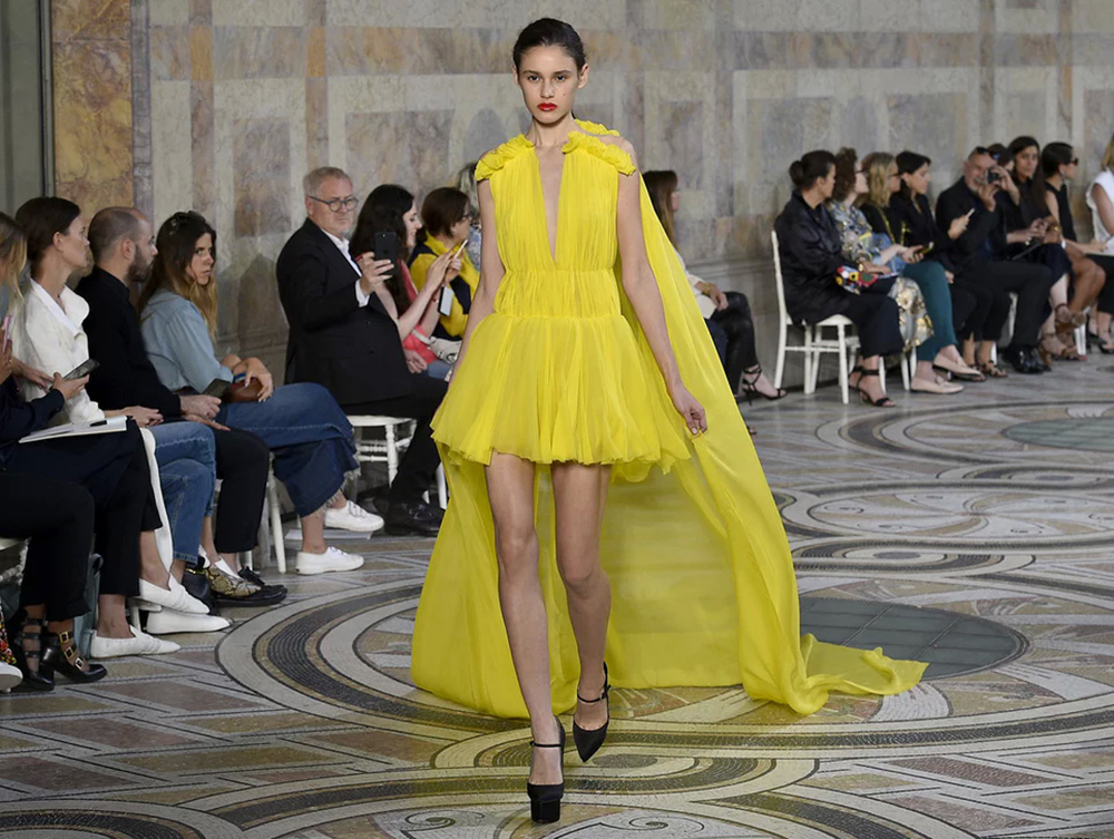 Power yellow on the Giambattista Valli catwalk. Photograph: Kristy Sparow/Getty Images. Photo courtesy of The Guardian