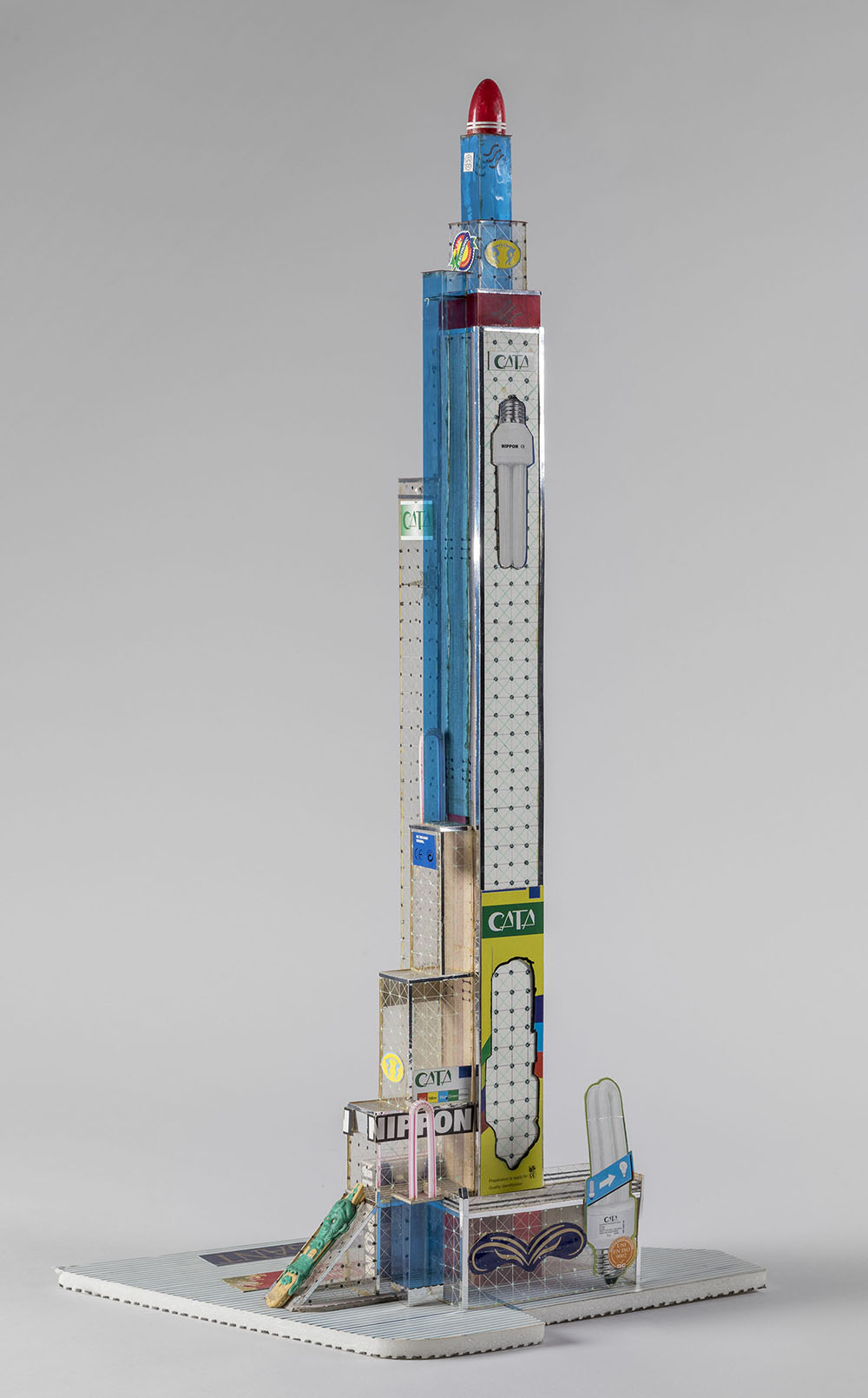 Bodys Isek Kingelez (Congolese, 1948-2015). Nippon Tower. 2005. Paper, paperboard, plastic, and other various materials, 26 3/8 × 13 3/8 × 8 11/16″ (67 × 34 × 22 cm), irreg. Courtesy Aeroplastics Contemporary, Brussels. Vincent Everarts Photography Brussels