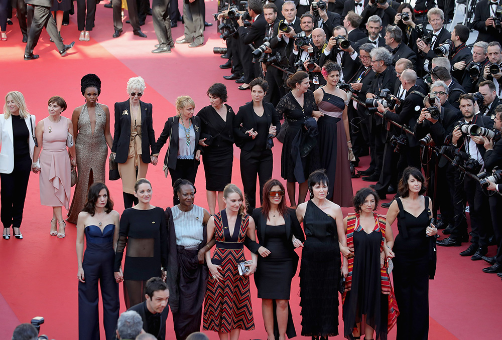 Female filmmakers on the red carpet in protest of the lack of female filmmakers honored throughout the history of the festival. Photo by Andreas Rentz/Getty Images