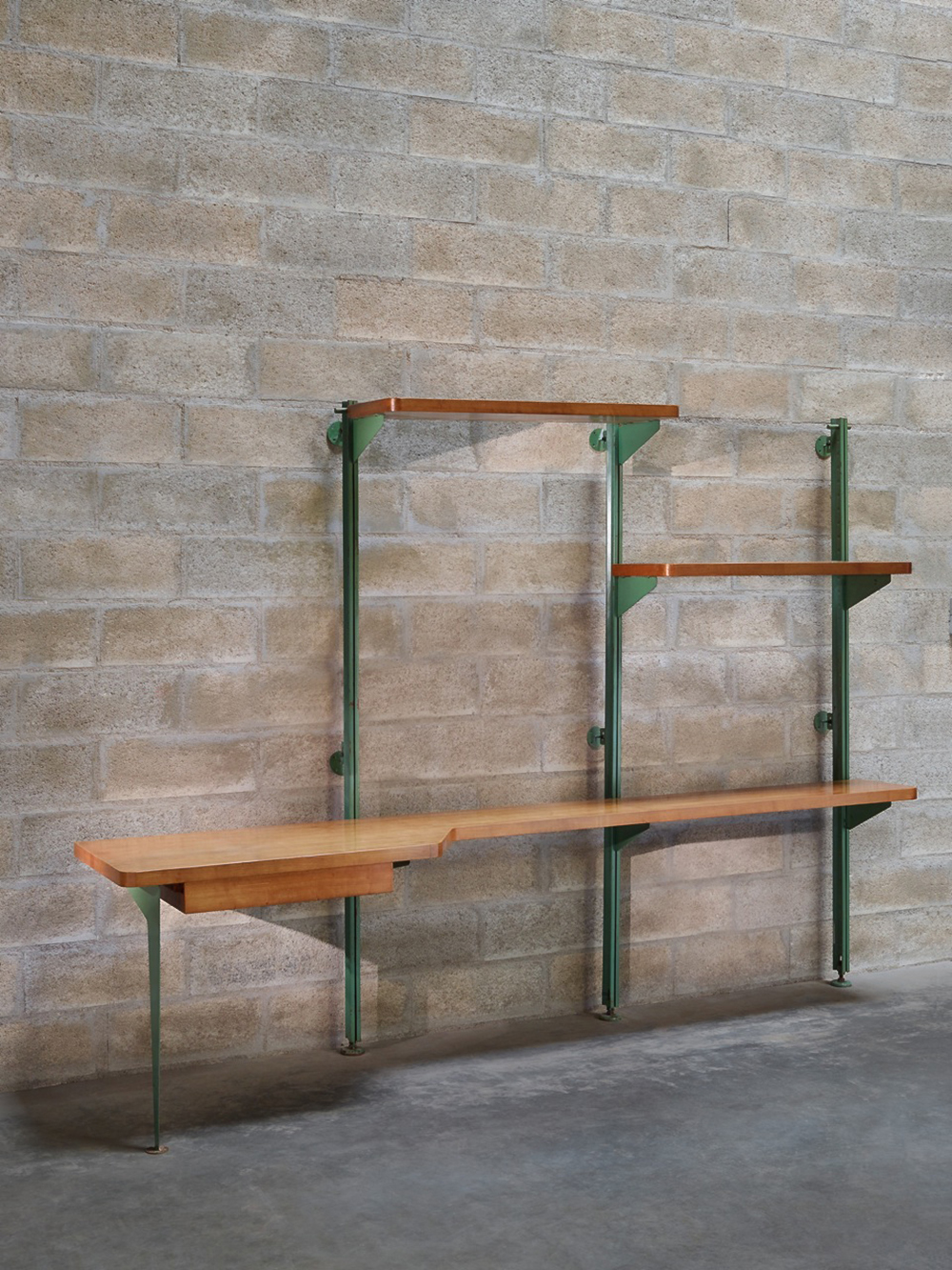 © Marie Clérin / Laffanour Galerie Downtown, Paris Jean Prouvé (1901-1984), Important special commissionned green lacquered steel and wild cherry wood suspended shelf comprising desk, 1951  81.50 x 110.50 x 27.50 in.