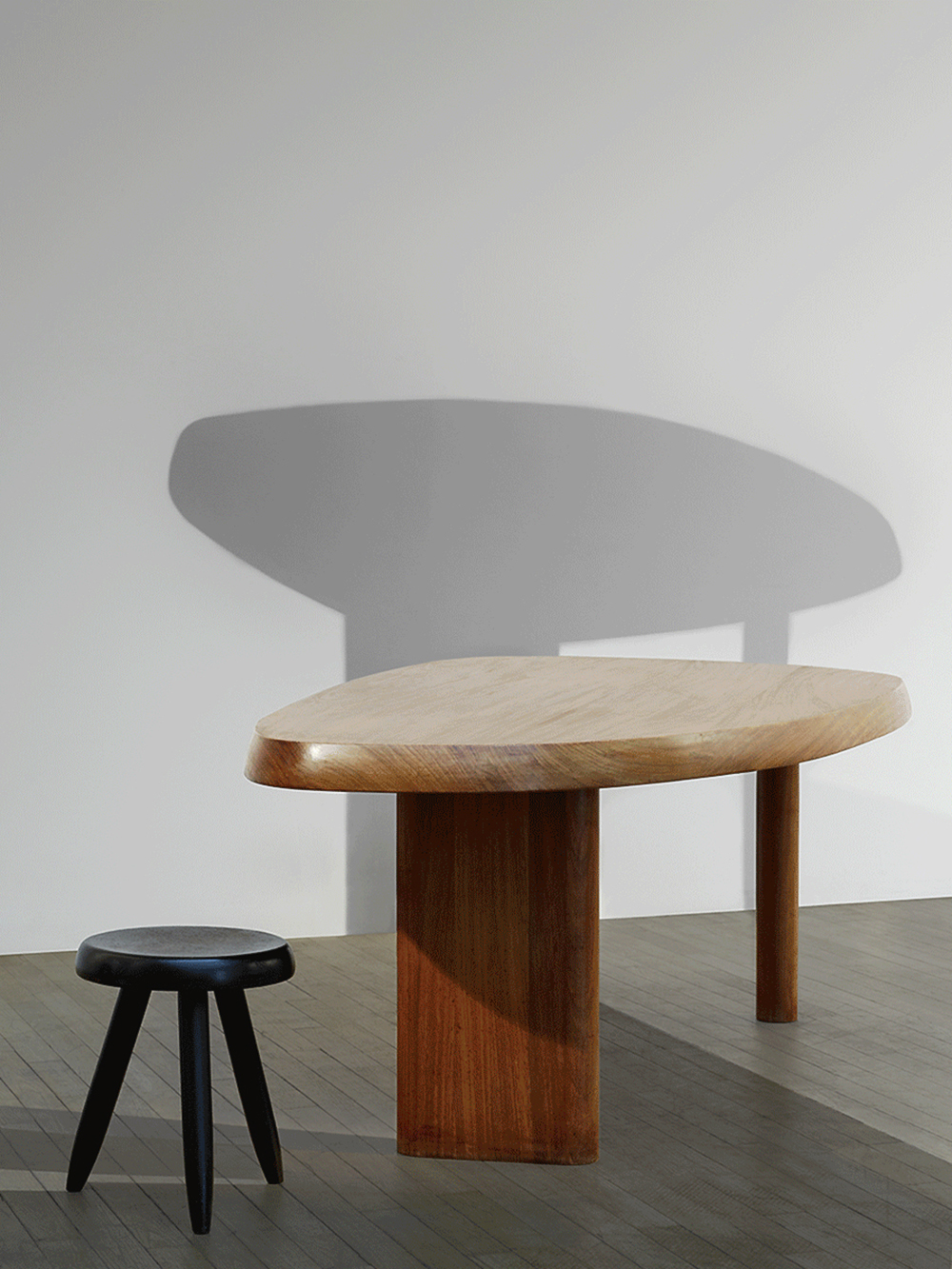 © Marie Clérin / Laffanour Galerie Downtown, Paris Charlotte Perriand (1901-1984), « Free-form » table, 1960 Free-form top made of ash resting on three legs (2 cylincal and 1 ovoïd). H. 27.9 x W. 95.7 x D. 42.7 x Thick. 2.4 in.