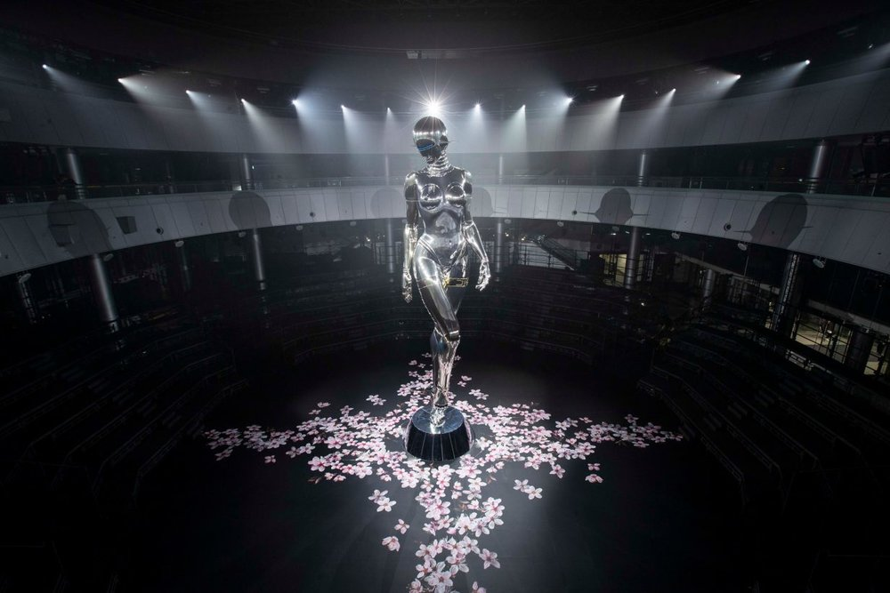 The robot was displayed with graphics of pink cherry blossoms on the surrounding floor