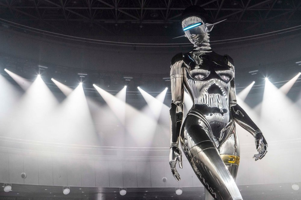 The robot's head resembles a helmet with a single illuminated rectangular slit for an eye and antennae for ears