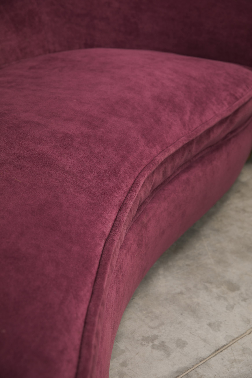 Curved sofa re-upholstered with red velvet,  5 cylindrical oak legs  H. 28,7 x L. 92,9 x W. 48 in.