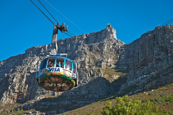 A walk in the clouds - We'll leave the city briefly, but only in a vertical sense, in order to get a better view! The Table Mountain Calbeway allows you to summit one of the 7 nature wonders of the world in just 5 minutes. 'A walk in the clouds' is how it's described by our very own tour companion, it's a sight and a feeling to behold.The floor of the circular cabin rotates to allow travelers 360° views and the mountain attracts nearly 1 million people each year, many of them return visitors. You won't miss out with us.