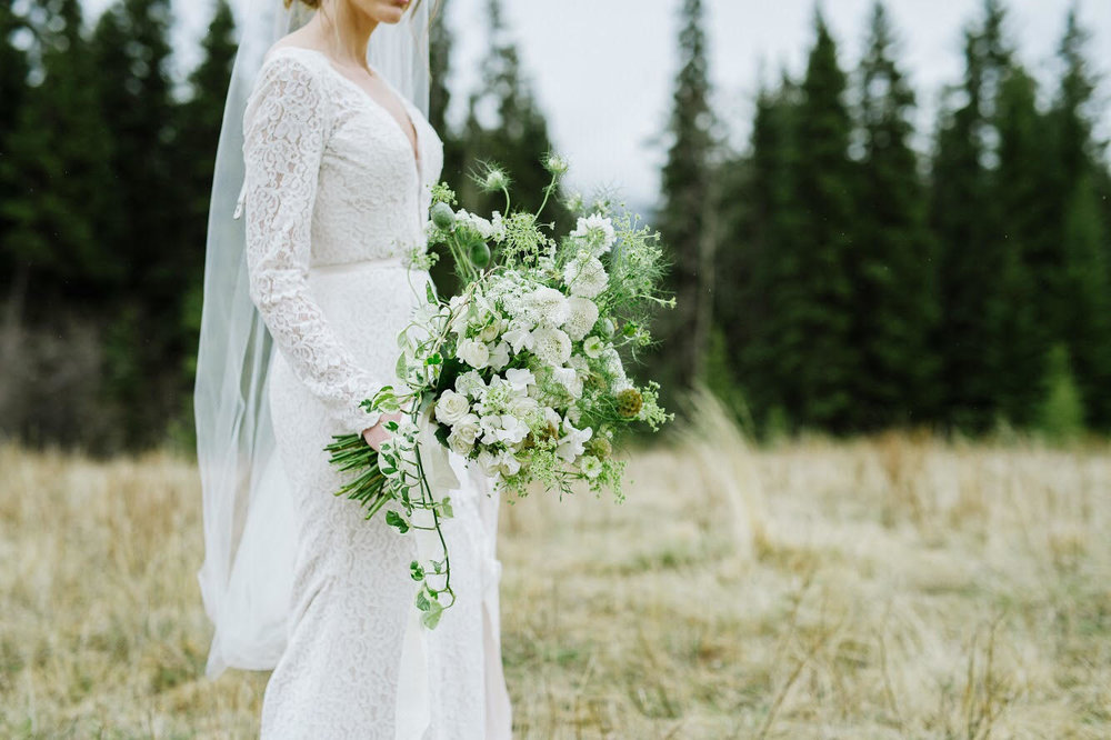 "The Sound of Music in Spring     Canmore, Alberta    Photos by Christy Swanberg  Ever dreamed of twirling atop a mountain like Julie Andrews in ""The Sound of Music?"" We have! Inspired by Edelweiss and the Bavarian Alps, this whimsical elopement celebrated spring in the Rockies. Thank you to Claudette Marie Events for trusting in us to fulfill their vision. This was featured on Cake and Lace."
