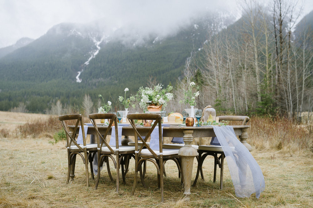 "Photos by Christy Swanberg  Ever dreamed of twirling atop a mountain like Julie Andrews in ""The Sound of Music?"" We have! Inspired by Edelweiss and the Bavarian Alps, this whimsical elopement celebrated spring in the Rockies. Thank you to Claudette Marie Events for trusting in us to fulfill their vision. This elopement was featured in print at Confetti Wedding Magazine."