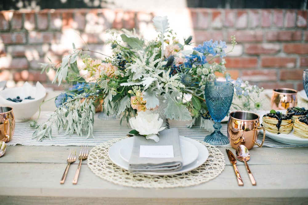 Photos by Corrina Walker  Inspired by the simplicity and laid back vibe of a garden brunch, the day was styled in a organic form. The bride's bouquet, floppy hat, and bridal party's rosemary bracelets were the ultimate accessories. Many gardenesque romantic details highlighted the day. Thanks to the wedding planners of Kismet & Clover in trusting us to execute their vision. This is featured on 100 Layer Cake.