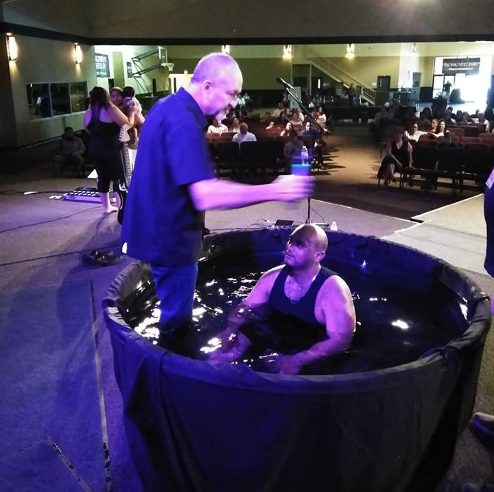 guy getting baptised.jpg