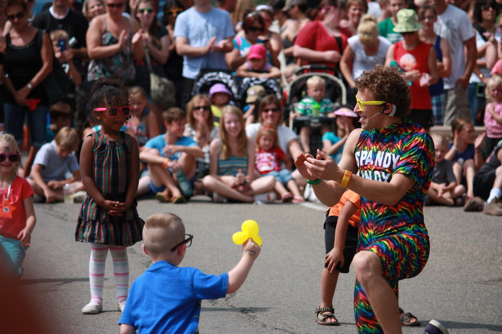 Child interacting with performer at CentreFest