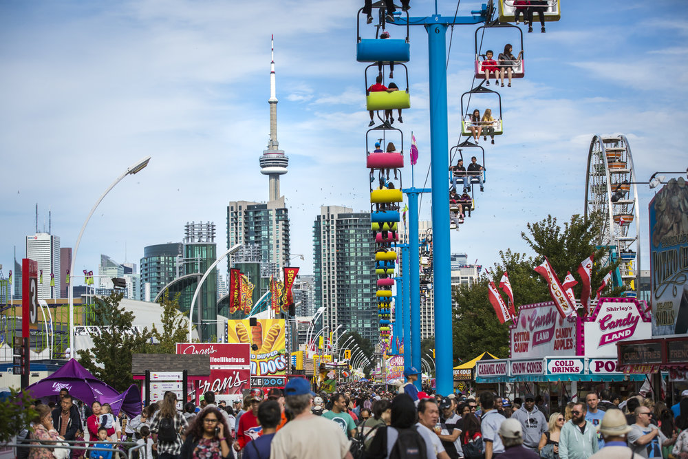 Rides at the CNE with the Toronto skyline in the back