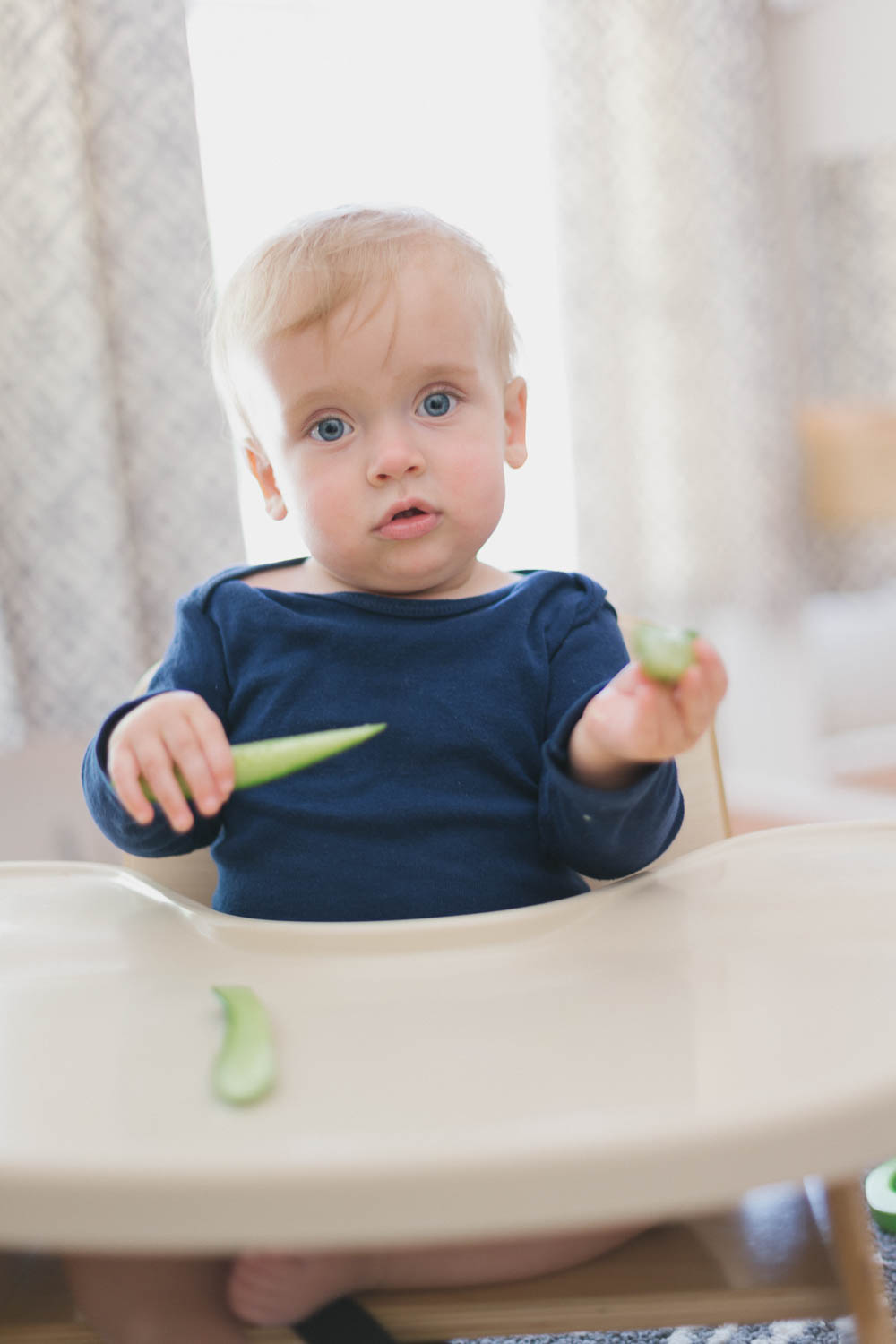 baby eating cucumber.jpg
