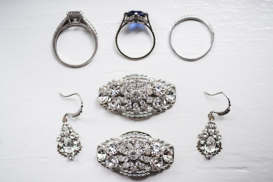 Detail of wedding rings and jewelry.