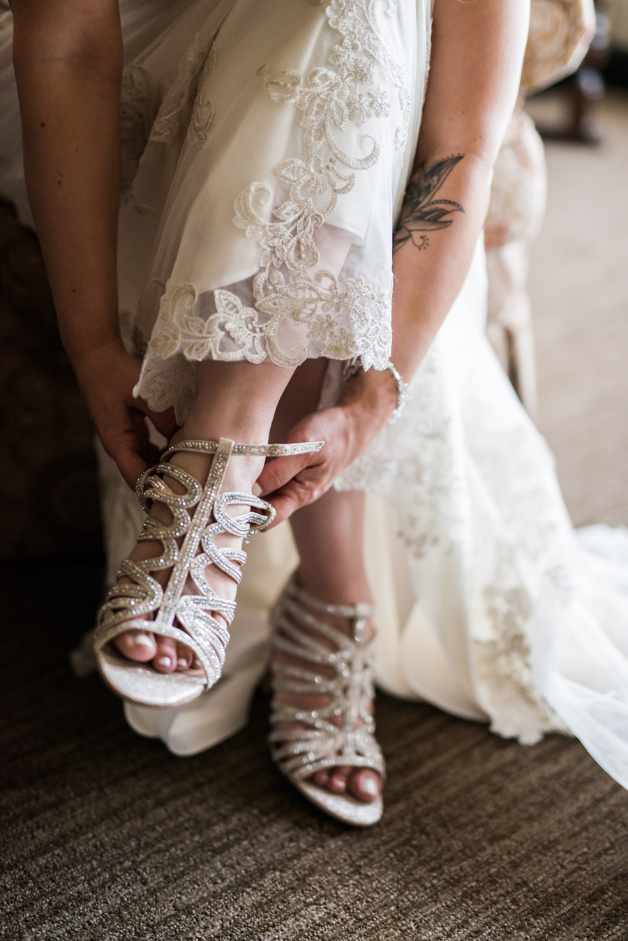 Bride puts on her shoes.
