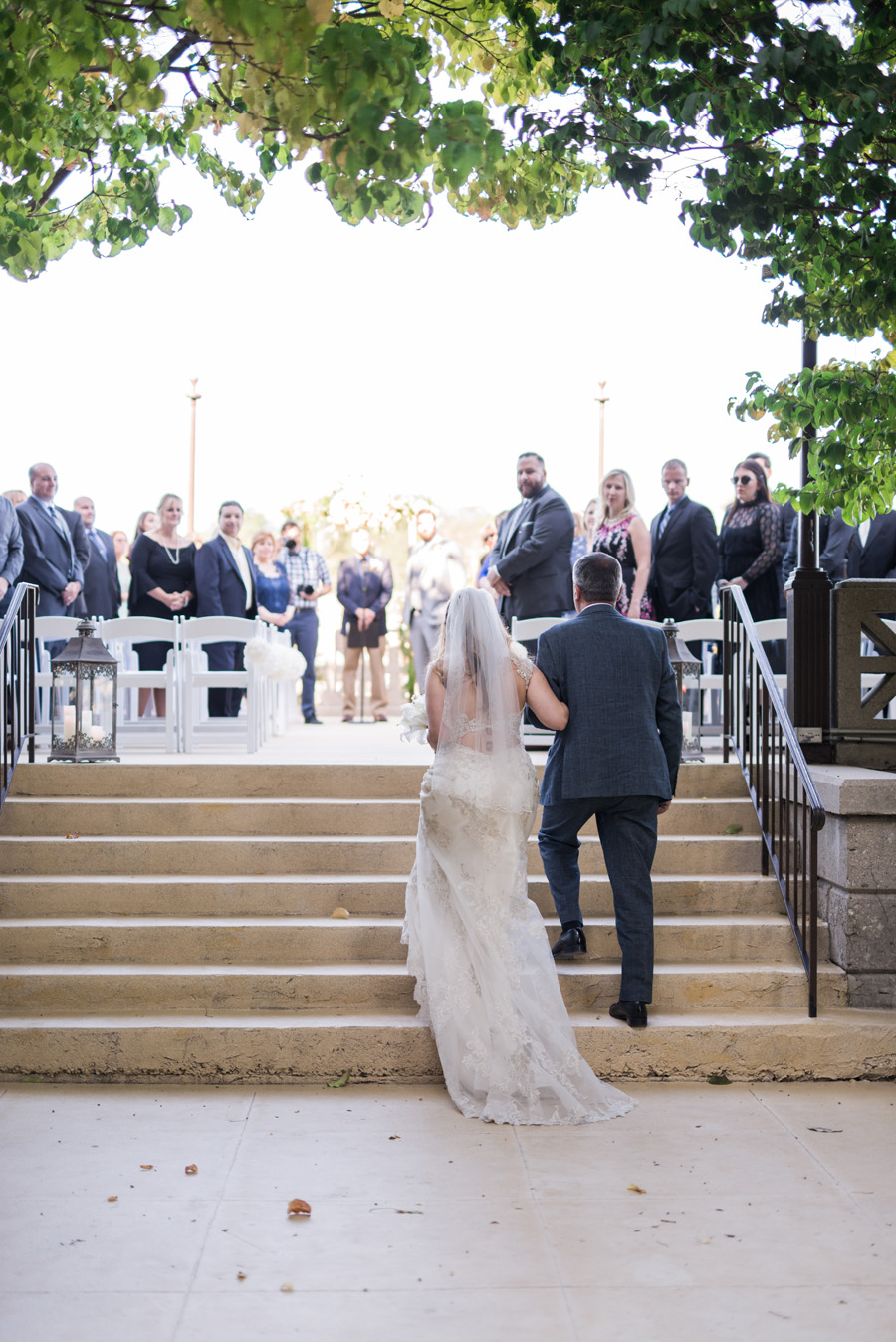 Dad escorts bride to her wedding ceremony.