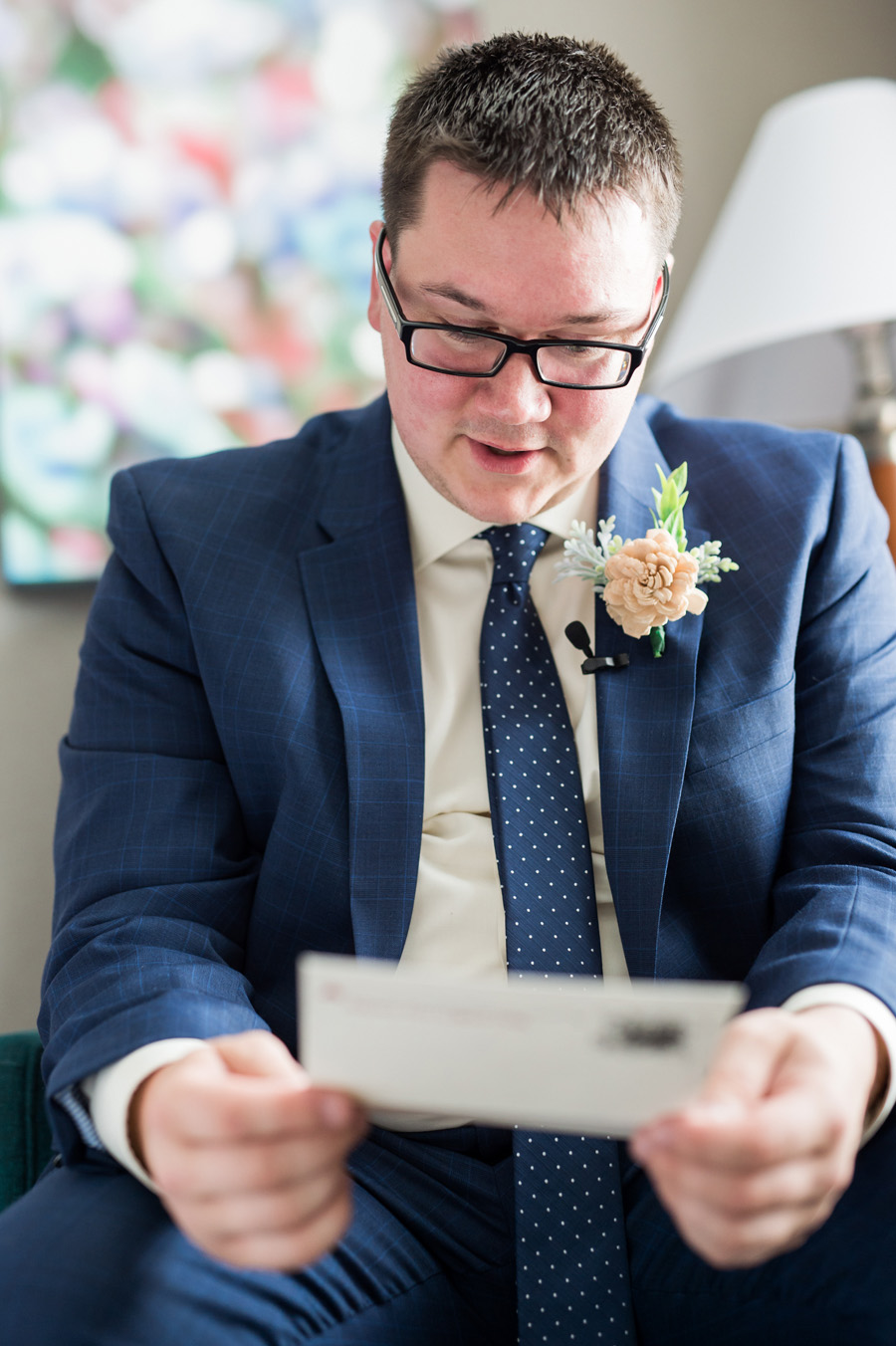 Groom reading letter from bride.