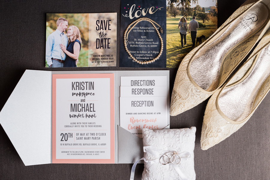 Wedding details and invitation all laid out.