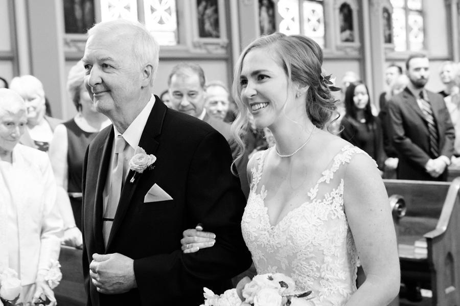 Dad walking his daughter down the aisle.
