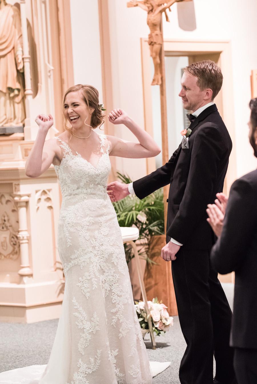 Bride reacting during wedding ceremony.