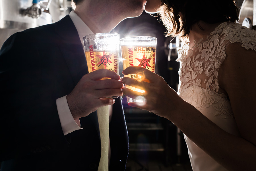 Bride and groom hold Cross of Gold beer at Revolution Brewing.