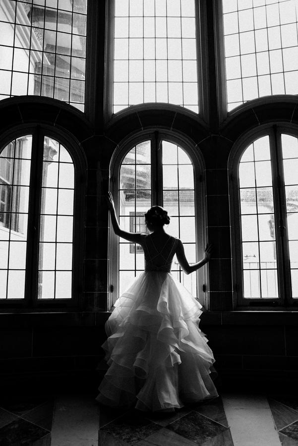 Bride in front of window.