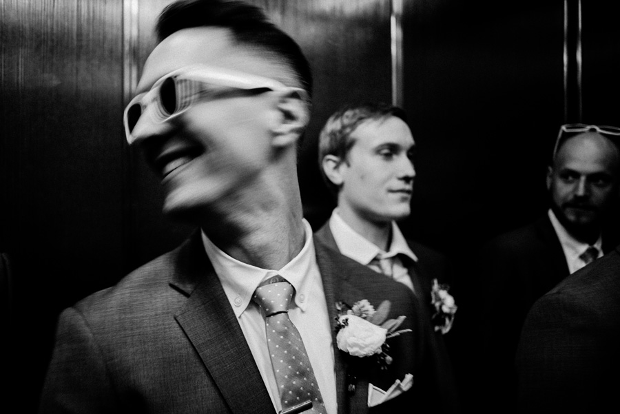 Groom in elevator.