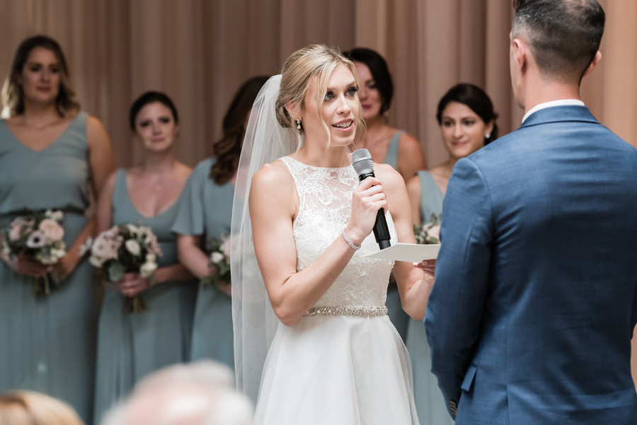 Bride says her vows at wedding ceremony.