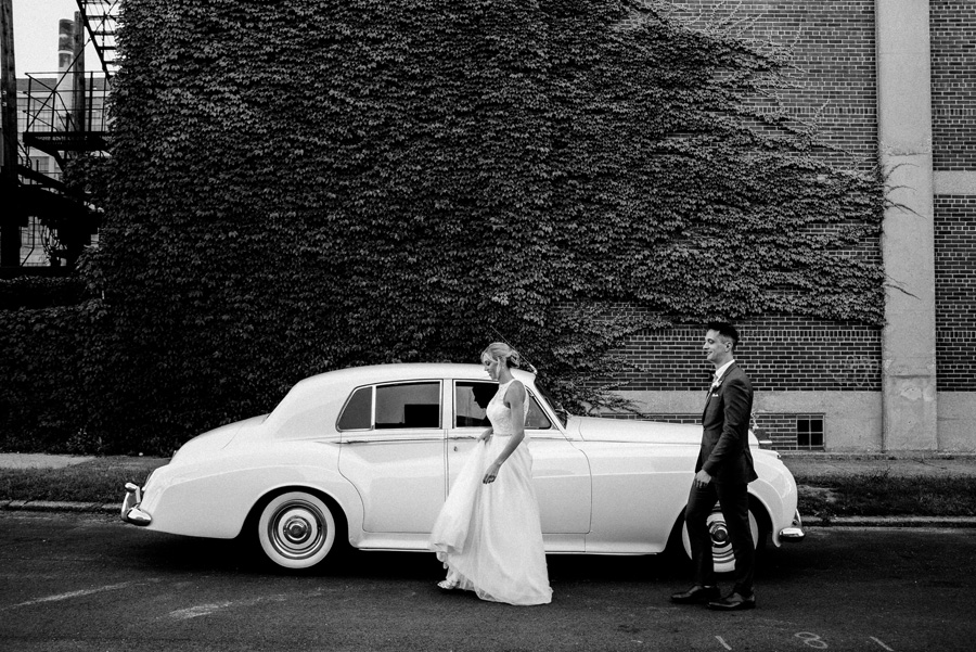 Bride and groom portraits with Rolls Royce.