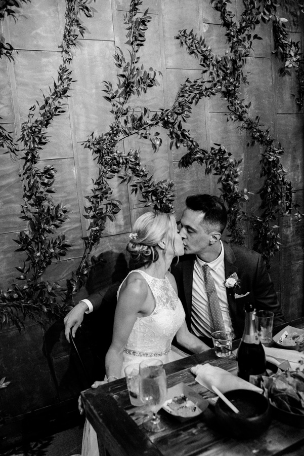 Bride and groom kiss at reception.