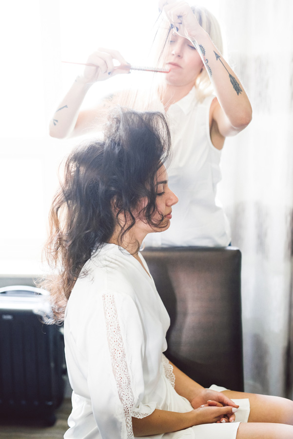 Bride gets her hair done.