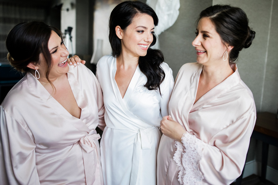 Bride and her bridesmaids in robes.