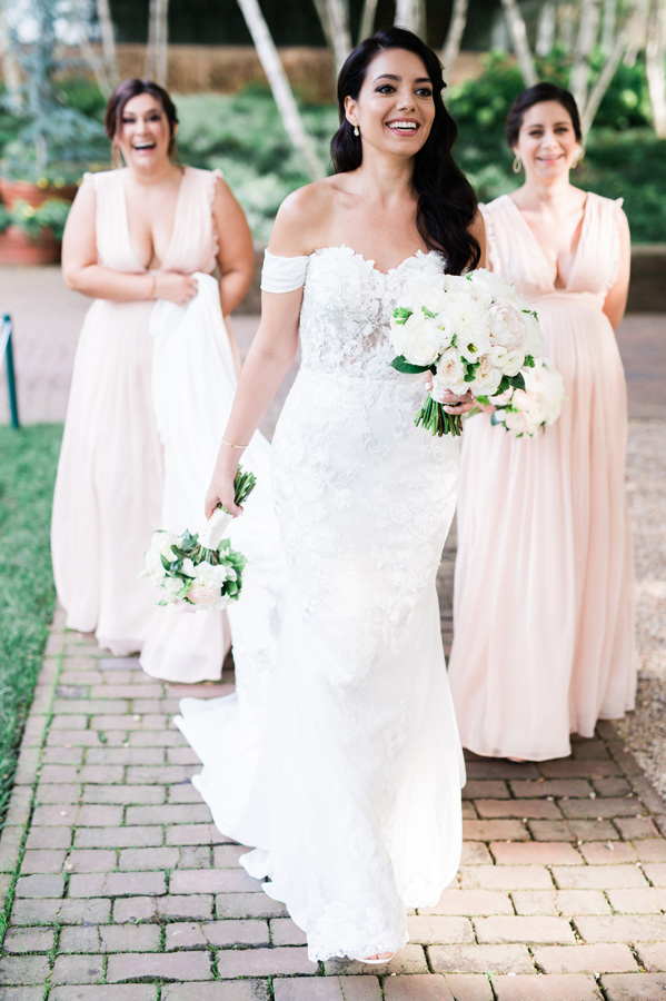 Candid of bride walking with bridesmaids.