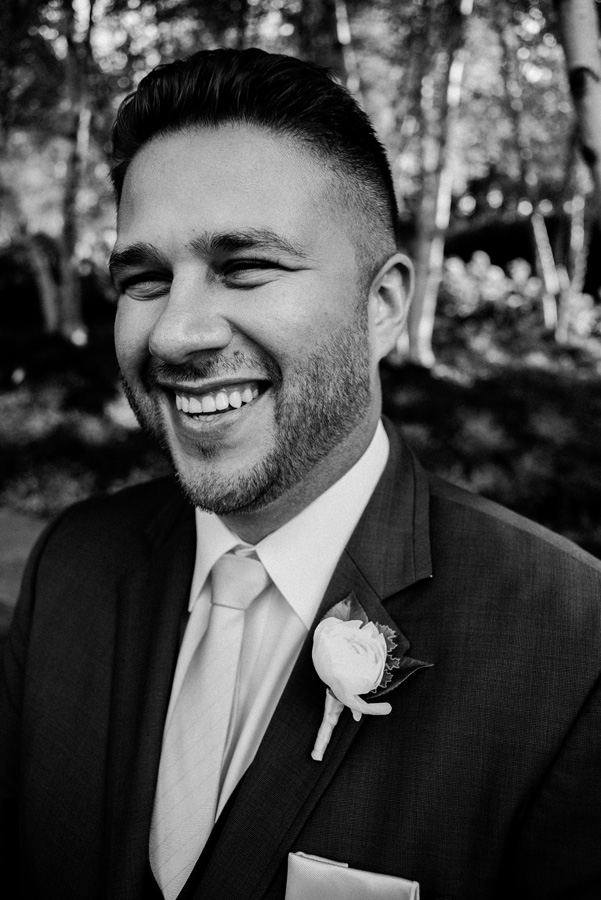 Black and white portrait of groom.
