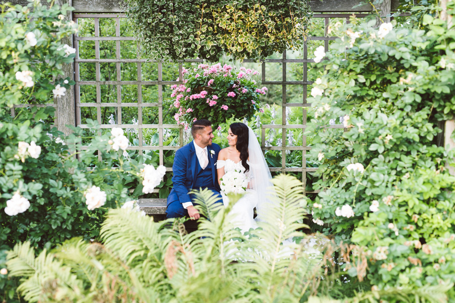 Bride and groom in Rose Garden at Chicago Botanic Garden.