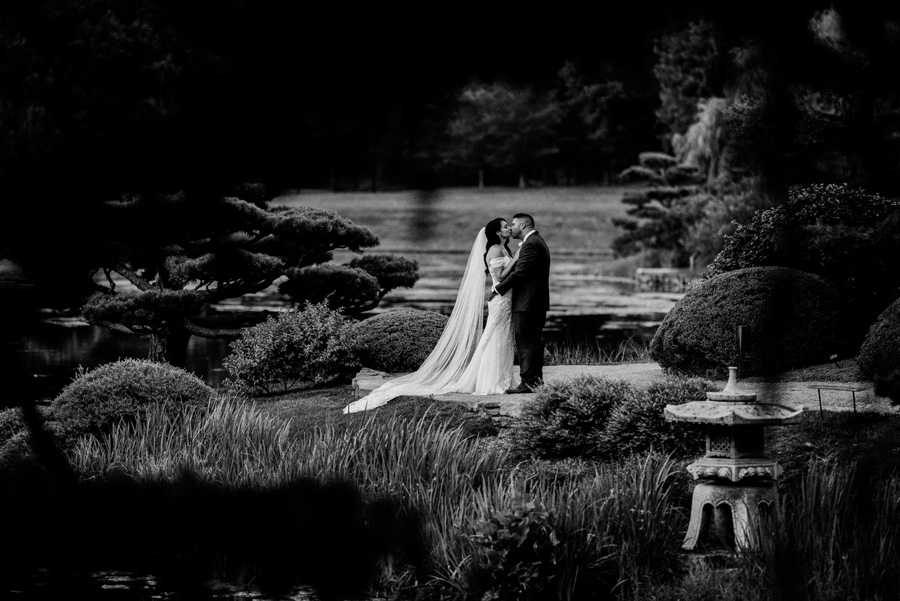 bride and groom kiss at Japanese Garden, Chicago Botanic Garden.