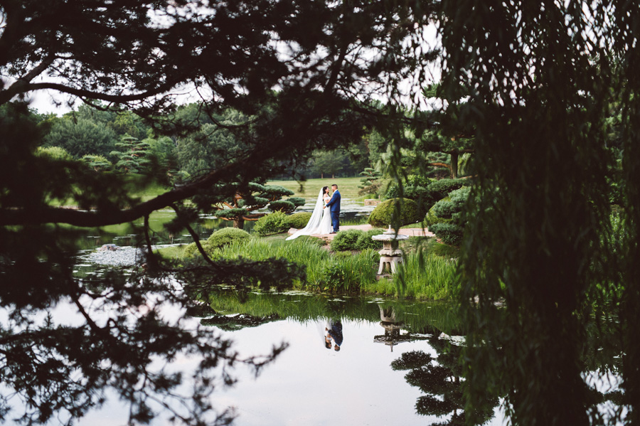 Bride and groom at the Japanese Garden in Chicago Botanic Garden.