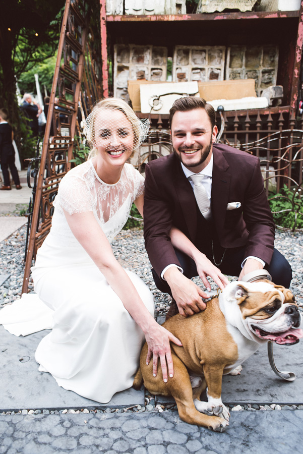 Bride, groom and their bulldog Bodie.